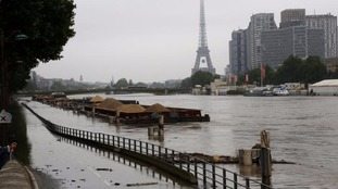 The swollen Seine burst its banks in Paris.