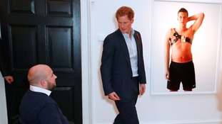 Rick speaks to Prince Harry at the launch of Bryan Adams' wounded servicemen photographic exhibition.
