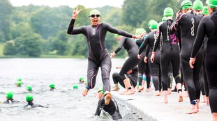 Mel C jumps for joy after completing the Blenheim Palace Triathlon for the charity Bloodwise.