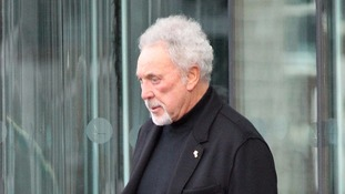 Sir Tom Jones breaks down in his first public appearance since his wife's death
