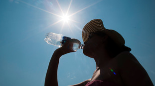 Woman drinking water in sunshine