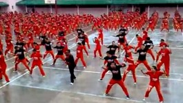 Inmates  perform South Korea star Psy's Gangnam Style.