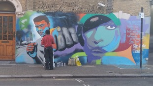 Graffiti artist creates mural of late boxer Muhammad Ali