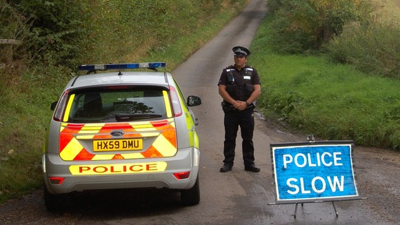 A police officer guards the closed off bridleway in Newton Stacey, near Andover,  where the bodies were found.
