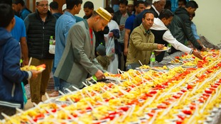 Men prepare to eat Iftar - the evening meal to break fast