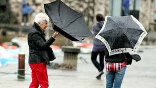 People struggle with umbrellas