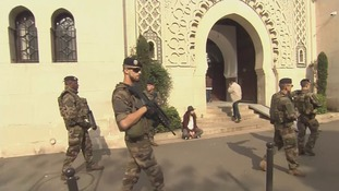 Soldiers stand guard outside the mosque.