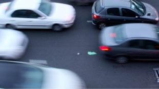 Queueing traffic due to debris on road on A38