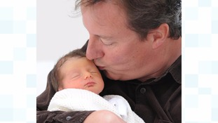 Prime Minister David Cameron with his newborn daughter Florence