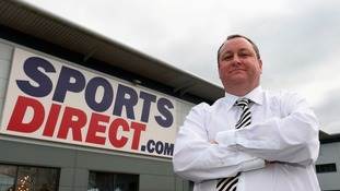 Mike Ashley in front of Sports direct store