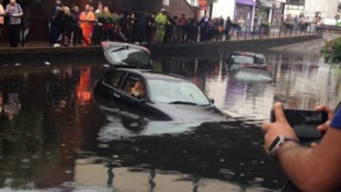 Flash flooding leaves roads underwater and cars submerged
