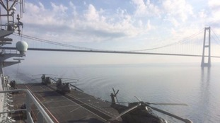 HMS Ocean sails under the Nyborg-Korsor bridge off Denmark