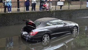 The Mercedes was submerged fully in the deluge before the water was pumped away