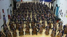 Students rehearse together in the school hall.