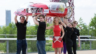 Countdown's Rachel Riley helps the team lift the 30kg vehicle