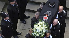 The coffin of PC Nicola Hughes is carried in to the Cathedral