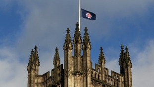 The Greater Manchester Police flag at half mast above Manchester Cathedral