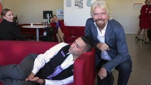 Richard Branson catches Virgin employee sleeping at work - and poses for sneaky picture