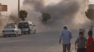 Smoke in the streets of Akcakale after the mortar bomb strikes