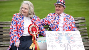 Royal fans Margaret Tyler and Terry Hutt celebrate on the Queen's real birthday.
