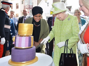 The Queen with Nadiya Hussain, winner of the Great British Bake Off who baked a cake for her actual birthday