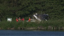 A woman, man and dog were found dead on the boat.