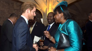 Prince Harry talks to the High Commissioner of Grenada, Karl Hood, and Acting High Commissioner for Dominica, Janet Charles