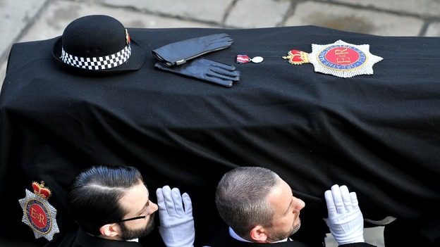 The coffin of Pc Fiona Bone is carried into Manchester Cathedral