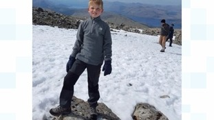 Seven-year-old boy becomes youngest climber to conquer highest peaks in England, Scotland and Wales
