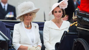 Camilla and Kate leaving the palace in a horse-drawn carriage