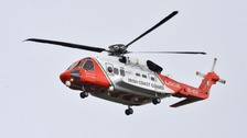 Searches continue for missing microlight passengers.