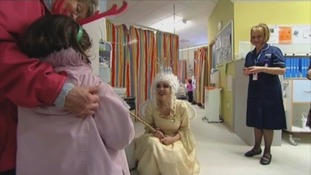 Emma Samms MBE visiting children in hospital during Panto season
