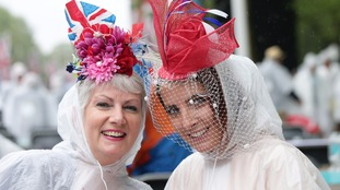 Anita Mead (left) and Lisa Kilby arrived early to the party and would not let the weather dampen their fashion.