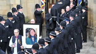 The coffin carrying the body of PC Fiona Bone is carried from the cathedral
