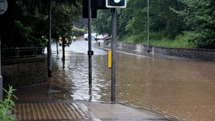 Roads have been closed after heavy rain caused flash flooding at the weekend.