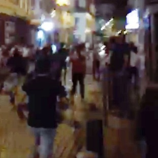 Fans flee from groups of locals in Marseilles.