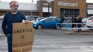 An anti-gun protester outside a Walmart store.