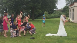 When you're an international rugby player, how else would you throw your wedding bouquet?