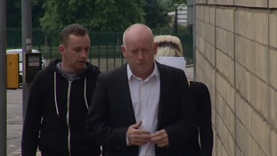 Claire Riley hid her face as she arrived at Northampton Crown Court with two men
