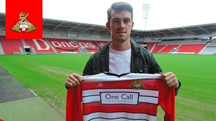 Doncaster Rovers sign John Marquis on two-year deal