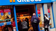 Customers queuing at Greggs