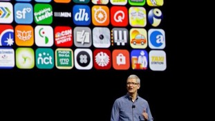 Tim Cook speaks on stage.