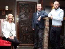 Rosemary Lightbody Tourism NI, Cormac McGeegan, Mary McBrides, and Patrick Lennon, Tourism Ireland, beside the latest GoT door in Cushendun.