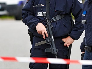 A roadblock has been established at the crime scene in the Paris suburb of Magnanville.