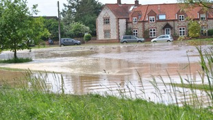 The village green at South Creake is awash