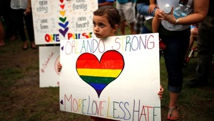 A child holds a placard during the vigil.