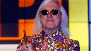 Sir Jimmy Savile pictured in the 'Top of the Pops' studio in 2003