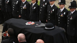 The hat, gloves and Queen's Jubilee medal, lay on top of the coffin of Pc Fiona Bone