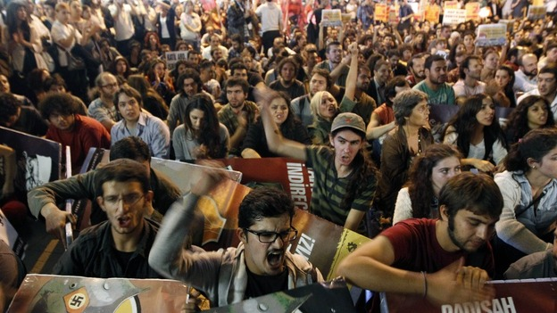 Protesters shout slogans during an anti-war demonstration in Istanbul