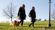 Couple of women walk two dogs